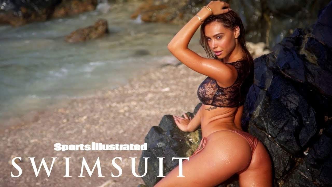 Watch Alexis Ren Get Hit By A Big Wave In Aruba   Sports Illustrated Swimsuit