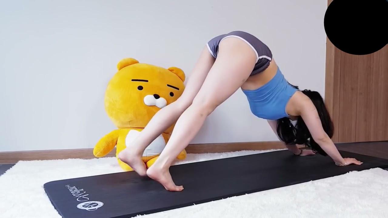 Sexy yoga teacher leg splits, flexibility, flexible girl stretching